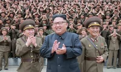North Korean leader Kim Jong Un claps with military officers at the Command of the Strategic Force of the Korean People's Army. KCNA/Reuters